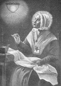 Anna Maria sitzt auf einem Stuhl und hat eine Vision in der Sonne, sie trägt eine weiße Haube auf dem Kopf und ein Skapulier über die Schulter, in die Sonne sieht sie eine Hostie sowie eine Dornenkrone zu sehen